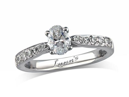 Platinum set single stone diamond engagement ring, with a certificated oval cut centre in a four claw setting, and diamond set shoulders. Perfect fit with a wedding ring. Total diamond weight: 0.60ct.