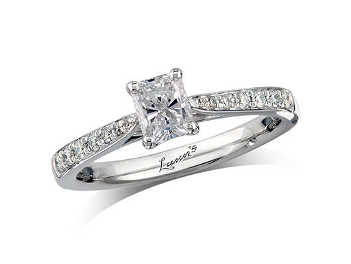 Platinum set single stone diamond engagement ring, with a certificated radiant cut centre in a four claw setting, and diamond set shoulders. Perfect fit with a wedding ring. Total diamond weight: 0.65ct.