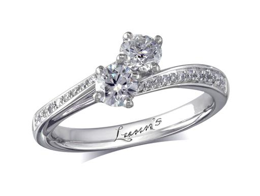 Platinum set two stone diamond engagement ring, with two certificated brilliant cuts, each in a four claw setting with diamond set shoulders. Perfect fit with a wedding ring. Total diamond weight: 0.73ct.