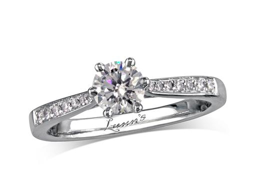 Platinum set single stone diamond engagement ring, with a certificated brilliant cut centre in a six claw setting, and diamond set shoulders. Perfect fit with a wedding ring. Total diamond weight: 0.56ct.