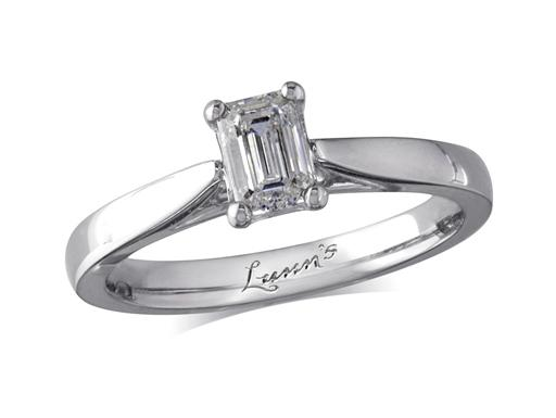 Platinum set single stone diamond engagement ring, with a certificated emerald cut, in a four claw setting. Perfect fit with a wedding ring.
