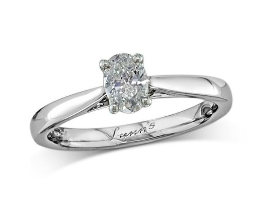 Platinum single stone diamond engagement ring, with a certificated oval cut, in a four claw setting. Perfect fit with a wedding ring.