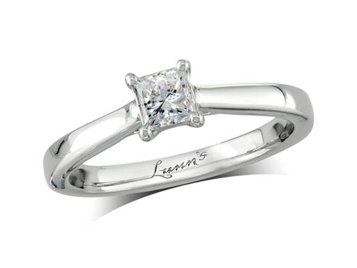 Platinum single stone diamond engagement ring, with a certificated princess cut, in a four claw setting. Perfect fit with a wedding ring.