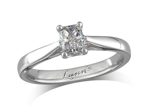 Platinum set single stone diamond engagement ring, with a certificated radiant cut, in a four claw setting. Perfect fit with a wedding ring.