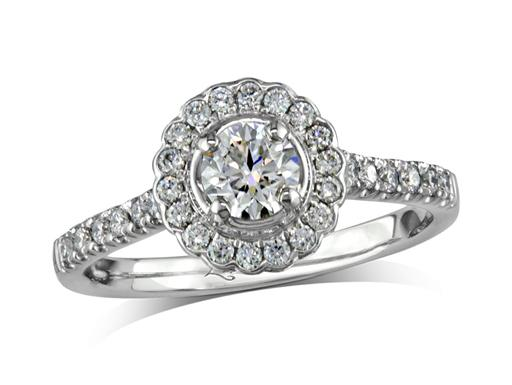 Platinum set diamond cluster engagement ring, with a certificated brilliant cut centre in a four claw setting, with a surrounding diamond set bezel and diamond set shoulders. Perfect fit with a wedding ring. Total cluster diamond weight: 0.70ct.