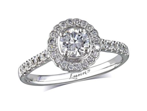 Platinum set diamond cluster engagement ring, with a certificated brilliant cut centre in a four claw setting, with a surrounding diamond set bezel and diamond set shoulders. Perfect fit with a wedding ring. Total cluster diamond weight: 0.76ct.