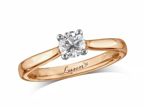 18 carat rose gold set single stone diamond engagement ring, with a certificated brilliant cut, in a four claw setting. Perfect fit with a wedding ring.