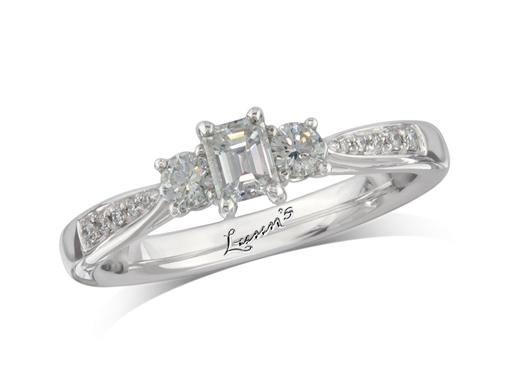Platinum set three stone diamond engagement ring, with a certificated emerald cut centre in a four claw setting, and one brilliant cut on each side with diamond set shoulders. Perfect fit with a wedding ring. Total diamond weight: 0.50ct.