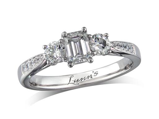 Platinum set three stone diamond engagement ring, with a certificated emerald cut centre in a four claw setting, and one brilliant cut on each side with diamond set shoulders. Perfect fit with a wedding ring. Total diamond weight: 0.78ct.