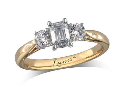 18 carat yellow gold three stone diamond engagement ring, with a certificated emerald cut centre in a four claw setting, and one brilliant cut on each shoulder. Perfect fit with a wedding ring. Total diamond weight: 0.82ct total.