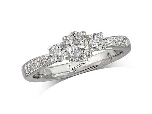 Platinum three stone diamond engagement ring, with a certificated oval cut centre in a four claw setting, and one brilliant cut on each side with diamond set shoulders. Perfect fit with a wedding ring. Total diamond weight: 0.55ct.