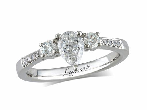 Platinum three stone diamond engagement ring, with a certificated pear cut centre in a three claw setting, and one brilliant cut on each side with diamond set shoulders. Perfect fit with a wedding ring. Total diamond weight: 0.75ct.