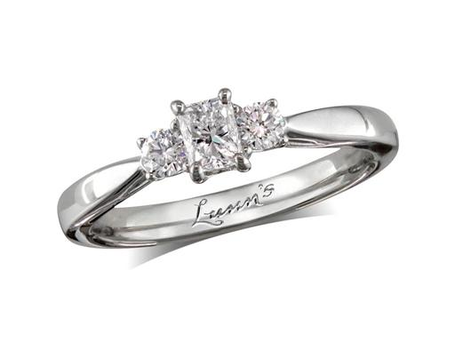 Platinum three stone diamond engagement ring, with a certificated radiant cut centre in a four claw setting, and one brilliant cut on each shoulder. Perfect fit with a wedding ring. Total diamond weight: 0.66ct.