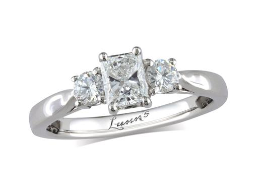 Platinum three stone diamond engagement ring, with a certificated radiant cut centre in a four claw setting, and one brilliant cut on each shoulder. Perfect fit with a wedding ring. Total diamond weight: 0.86ct.