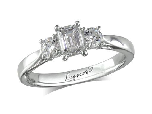 Platinum three stone diamond engagement ring, with a certificated emerald cut centre in a four claw setting, and one brilliant cut on each shoulder. Perfect fit with a wedding ring. Total diamond weight: 0.72ct.