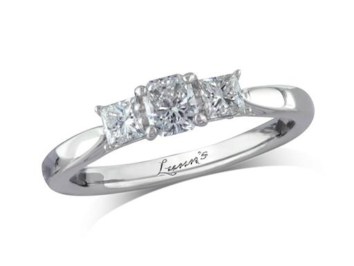 Platinum three stone diamond engagement ring, with a certificated radiant cut centre in a four claw setting, and one princess cut on each shoulder. Perfect fit with a wedding ring. Total diamond weight: 0.64ct.