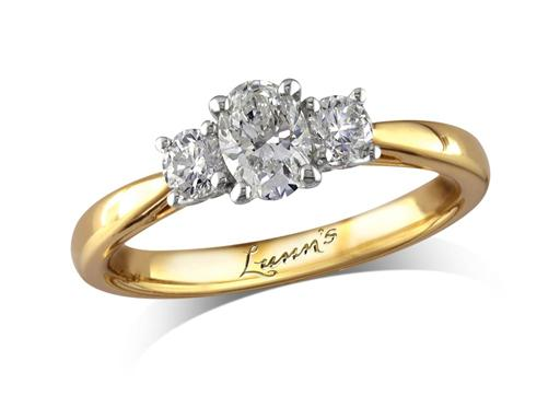18 carat yellow gold set three stone diamond engagement ring, with a certificated oval cut centre in a four claw setting, and one brilliant cut on each shoulder. Perfect fit with a wedding ring. Total diamond weight: 0.57ct.
