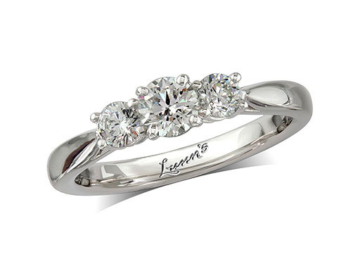 Platinum set three stone diamond engagement ring, with a certificated brilliant cut centre in a four claw setting, and one brilliant cut on each shoulder. Perfect fit with a wedding ring. Total diamond weight: 0.62ct.
