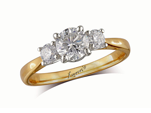 18 carat yellow gold set three stone diamond engagement ring, with a certificated brilliant cut centre in a four claw setting, and one brilliant cut on each shoulder. Perfect fit with a wedding ring. Total diamond weight: 0.60ct.